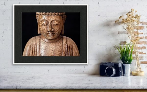 Wall art photography of the Buddha with dark mount and white frame.