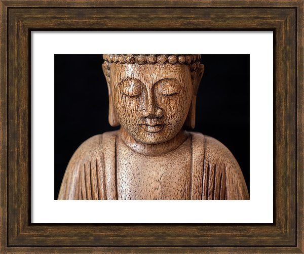 Fine art photography of the Buddha with thick brown wooden frame.